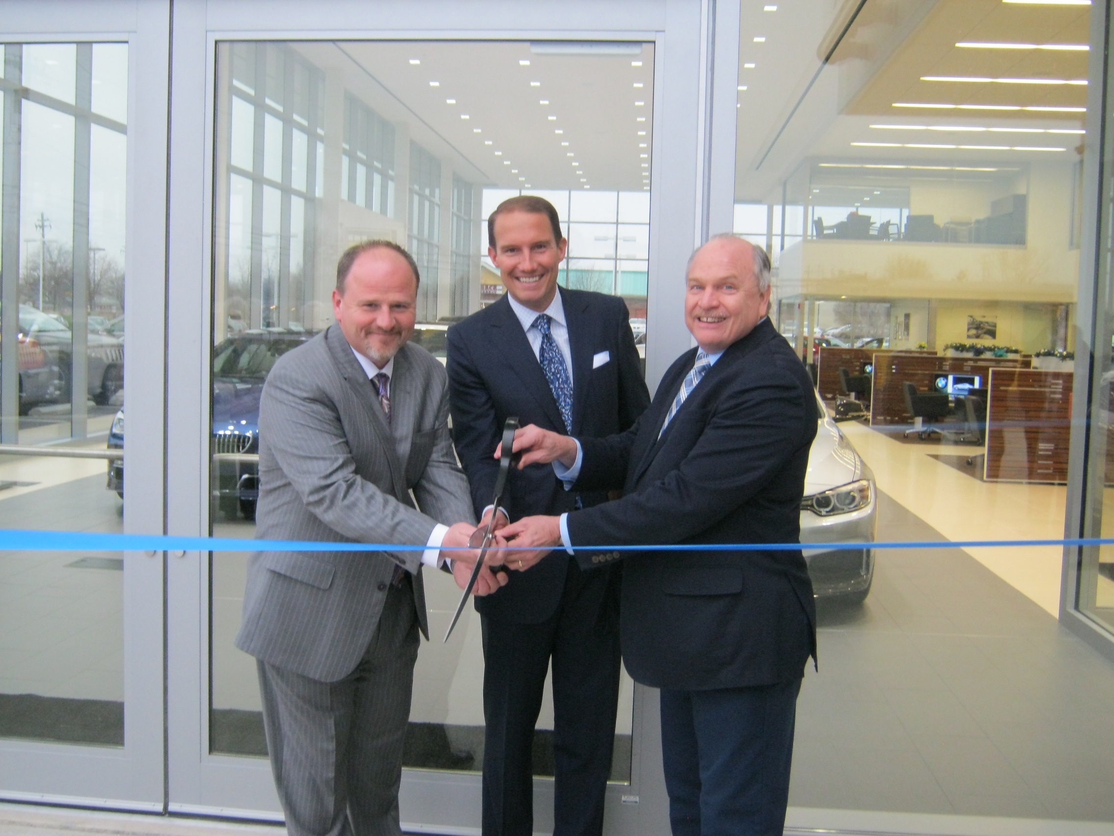 Adam moon of bmw of westlake l to r along with ken ganley of the ganley auto group and westlake mayor dennis clough cut the ribbon on the new store